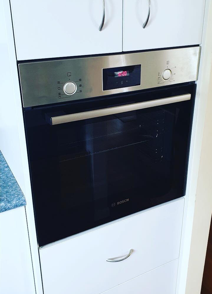 After image of kitchen with oven prominent