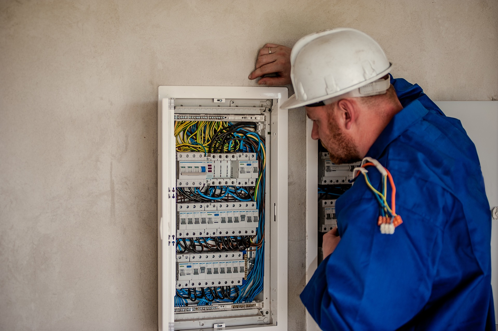 Services - Electrician working on a power box