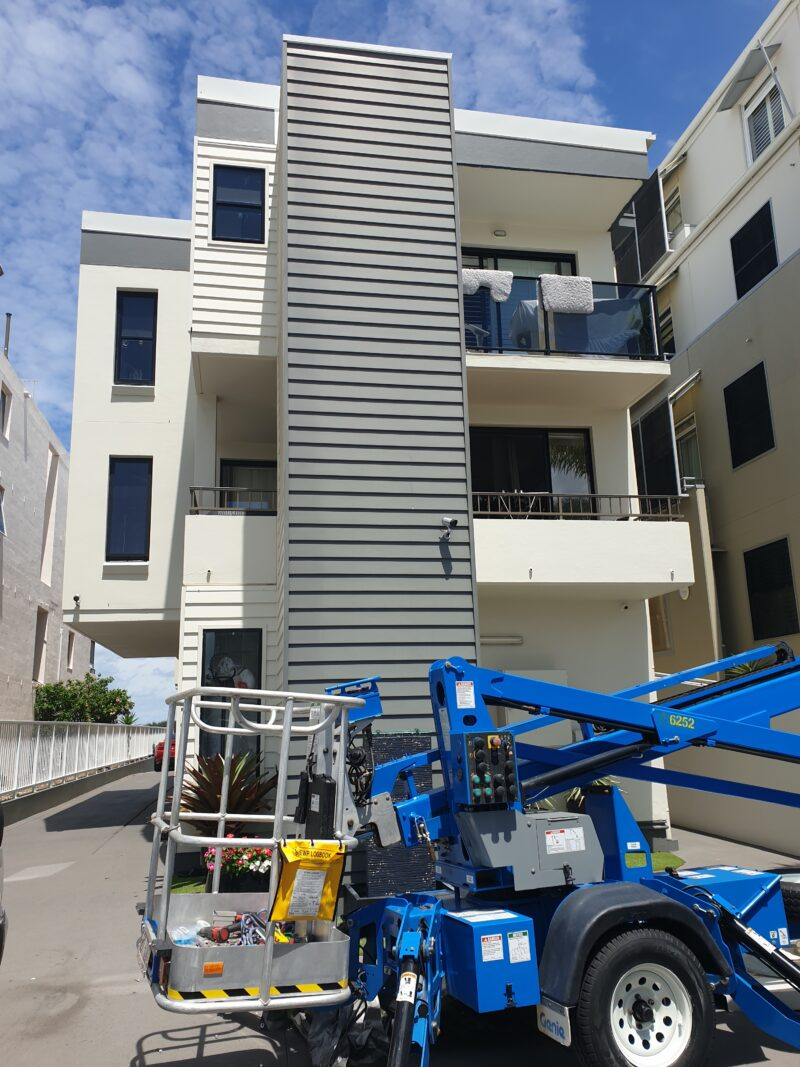 Ausco Industries services lift installed outside a block of flats